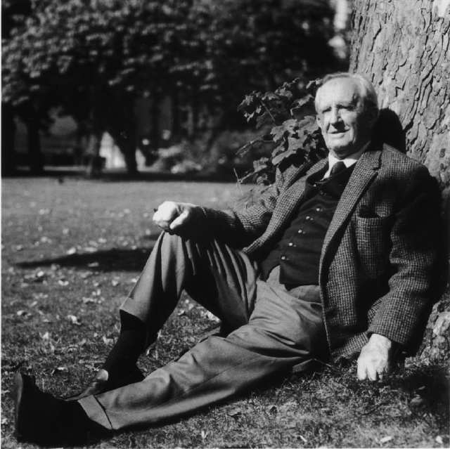 J.R.R. Tolkien leaning against tree